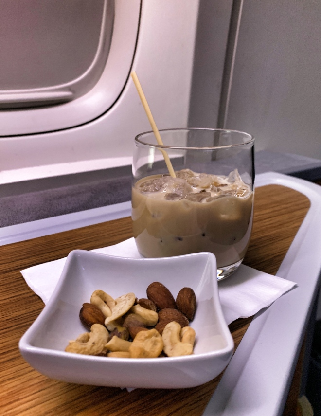 Glass of Bailey's on the rocks and a dish of warm peanuts.