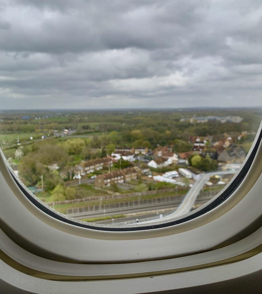 Look outside of plane window as flight lands in London