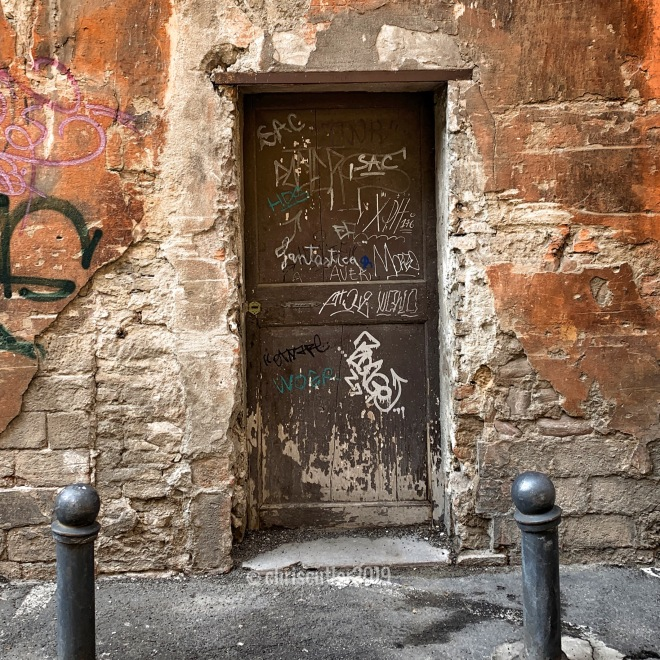 Brown door covered in graffiti