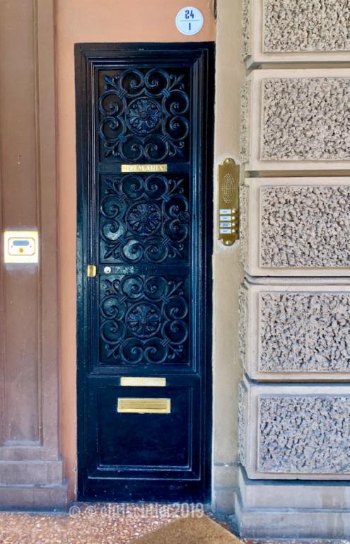 Black wrought iron door in Bologna