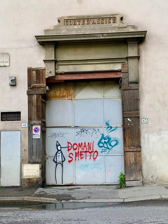 Grey metal door with graffiti