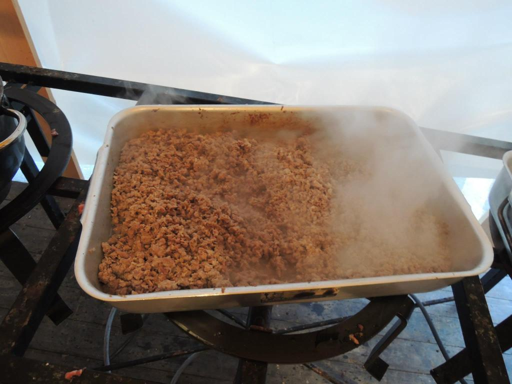 A pan of crumbled sausage sitting on a stove