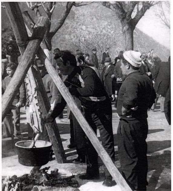 Men stirring a pot of polenta in 1962