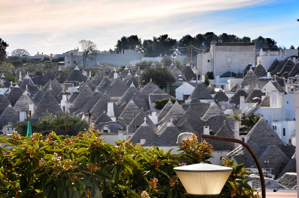 Overview of historic Alberobello with roofs of trulli sticking up